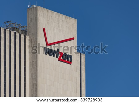 NEW YORK,USA-JULY 3,2015:Verizon signage and logo on its building at 375 pearl street, New York city. The building is windowless and has a simple architecture. - stock photo