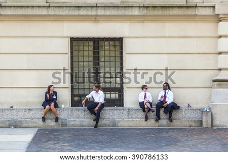 NEW YORK, USA - JULY 11, 2010: workers at Metropolitan museum have a break in the sun. They enjoy the good weather outside the metropolitan Museum. - stock photo
