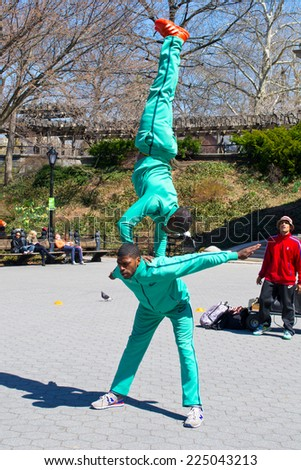NEW YORK, USA - MARCH 26: Unknown street actors in the central park on March 26, 2014 in New York, USA - stock photo