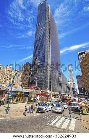 NEW YORK, USA - MAY 06, 2015: Corner of Eight Avenue and 33rd street in New York City with the Empire State Building skyscraper in the background - stock photo