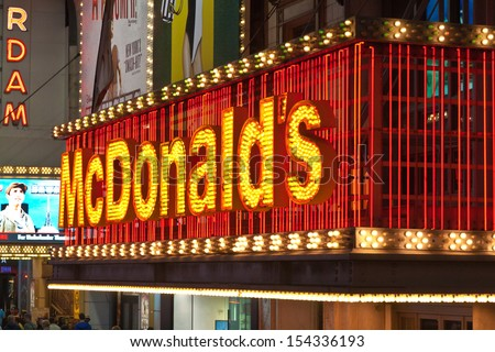 NEW YORK, USA, MAY 10th, 2013. World famous McDonalds fast food chain entrance neon signs along 42nd street in Times Square, New York City, USA. Taken on May 10th, 2013. - stock photo