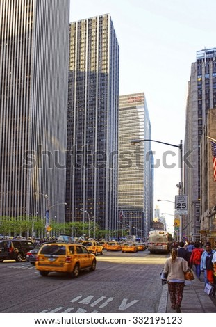NEW YORK, USA - MAY 07, 2015: Typical Manhattan scenery with yellow cabs speeding through busy street of New York City, USA.                  - stock photo