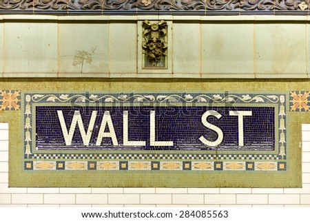 New York, USA - May 31, 2015: Wall street subway sign tile pattern in New York City Manhattan station. - stock photo
