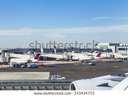 NEW YORK, USA - OCT 20, 2015: Air Traffic Control Tower and Terminal 4 with Air planes at the gates in JFK Airport in NY. 1963 the airport was rededicated John F. Kennedy International Airport. - stock photo