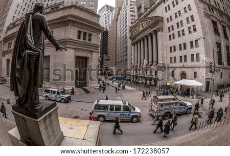 NEW YORK, USA - OCTOBER 10: Wide-angle view of the Business and Financial center of the USA, The Wall Street and its Stock Exchange with locals and tourists passing by in a rush on October 10, 2013. - stock photo