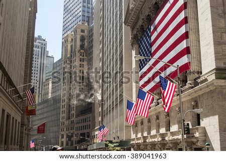 New York, USA  SEPTEMBER 2015: American flags in Wall Street during the 11S memorial  on 11th September 2015 in New York. - stock photo