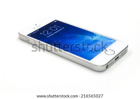New York, USA - September 10, 2013: Studio shot of a white iPhone 5s showing the home screen with iOS7. Isolated on white - stock photo