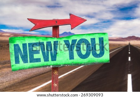 New You sign with road background - stock photo