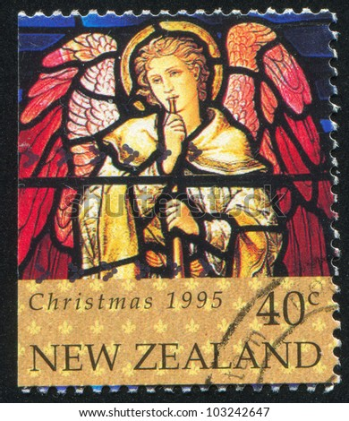 NEW ZEALAND - CIRCA 1995: A stamp printed by New Zealand, shows Stained Glass Window Depicting Angel with Trumpet, circa 1995 - stock photo