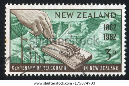 NEW ZEALAND - CIRCA 1962: stamp printed by New Zealand, shows Morse Key and Port Hills, Lyttelton, circa 1962 - stock photo