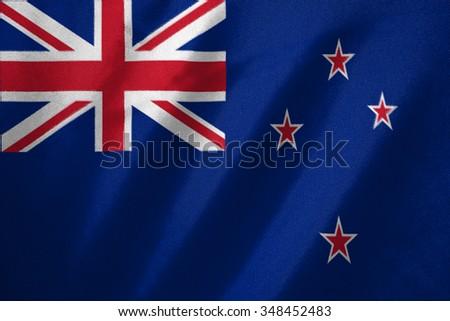 new zealand flag on fabric background - stock photo