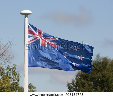 New Zealand flag waving in the wind.  - stock photo