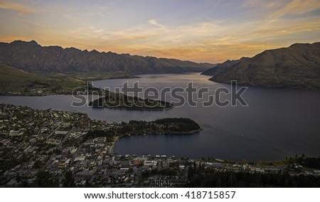 New Zealand, panoramic view of Queenstown and lake Wakatipu at dusk - stock photo