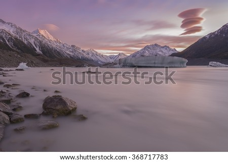 NEW ZEALAND 18TH APRIL 2014 ; Lenticular clouds pass over Mt Cook South Islands New Zealand during a beautiful morning - stock photo