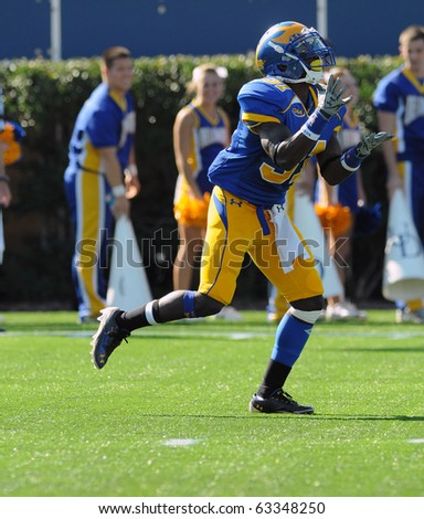 NEWARK, DE - OCTOBER 9: University of Delaware wide receiver Phillip Thaxton runs up to catch a punt in a game against Maine October 9, 2010 in Newark, DE. - stock photo