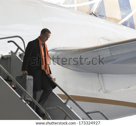 NEWARK, NJ - JANUARY 26, 2014: Denver Broncos Peyton Manning arrives on United flight 1825 charter Boeing 767-400 plane at Newark Liberty Airport for the NFL Super Bowl XLVIII football game - stock photo