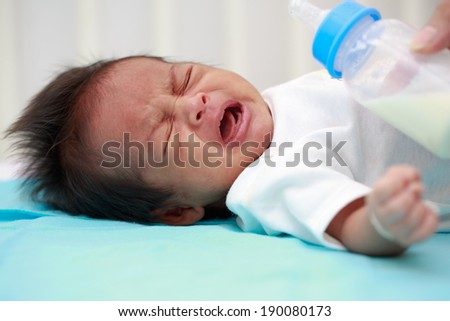 Newborn Asian baby crying because feeding hungry. 27 days after birth - stock photo