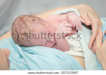 newborn baby after birth - stock photo