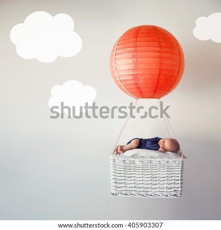 Newborn baby asleep in dreamland - stock photo