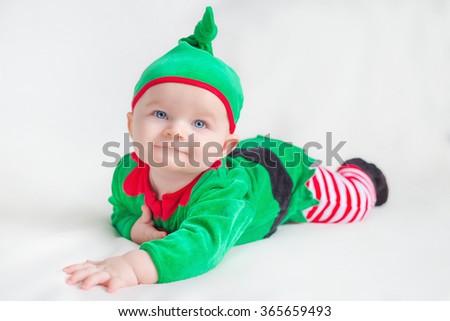 Newborn baby boy dressed in gnome costume lying - stock photo