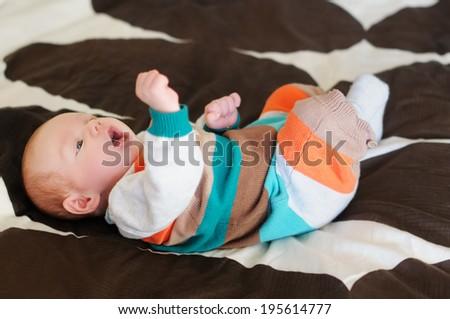 Newborn baby boy, indoors portrait - stock photo