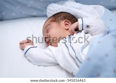 Newborn baby boy sleeping in his bed. Newborn Sleep. Two days old in maternity  - stock photo