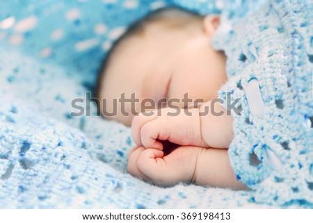 Newborn baby boy sleeping. Love sign - stock photo
