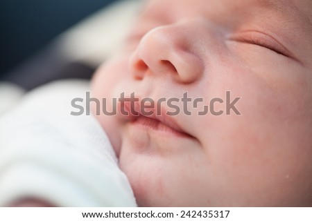 Newborn - baby, face close-up (shallow depth of field) - stock photo