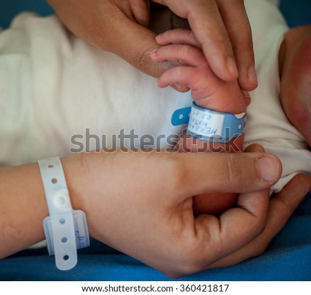 Newborn baby first days of life - stock photo