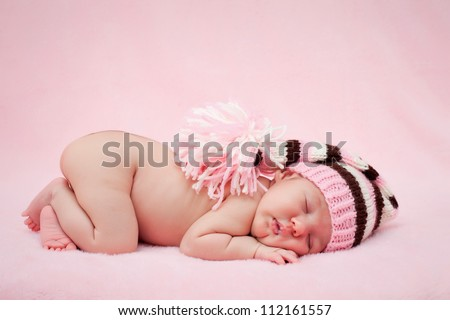 Newborn baby girl right after delivery.Sweet baby girl portrait. Use the photo to represent life, parenting or childhood. Shallow focus. - stock photo