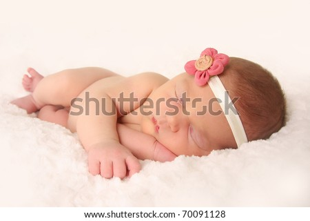 Newborn baby girl, sleeping. - stock photo