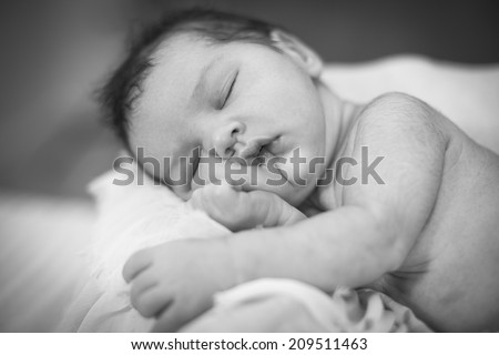 Newborn baby girl sleeping Black-white image - stock photo