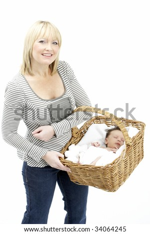 Newborn Baby Held In Basket By Mother - stock photo