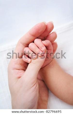 newborn baby holding mammies finger - stock photo