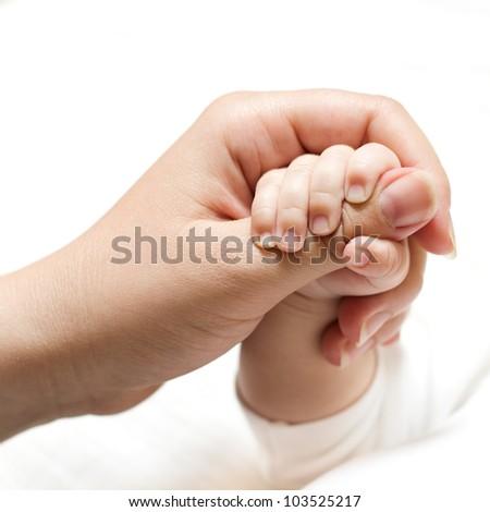 Newborn baby holding mother hand. - stock photo