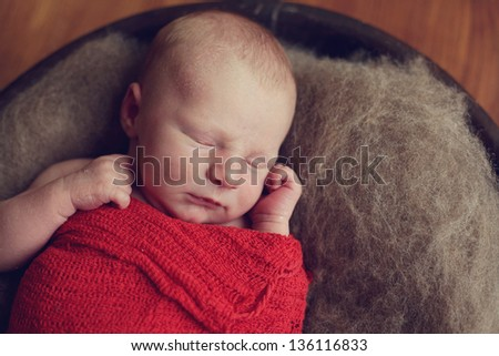 Newborn Baby in a wood bowl - stock photo