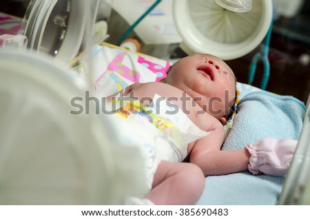 Newborn baby in hospital post delivery room,Selective Focus - stock photo
