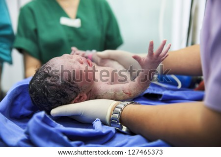 Newborn baby in labor room - stock photo