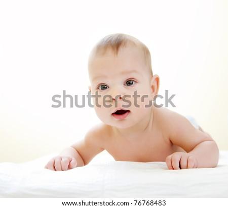 Newborn baby on white towel - stock photo