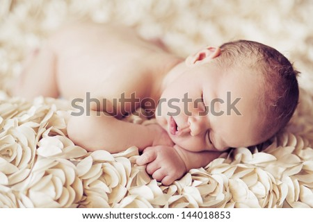 Newborn baby peacefully sleeping - stock photo
