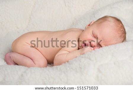 Newborn baby peacefully sleeping  - stock photo