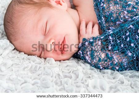 newborn baby sleep on the blanket - stock photo