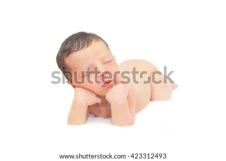 Newborn baby sleeping and resting on hands on white background. - stock photo