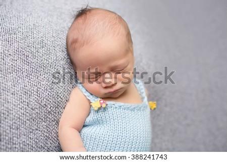 Newborn baby sleeping on blanket, asleep, posed, parenting concept. - stock photo