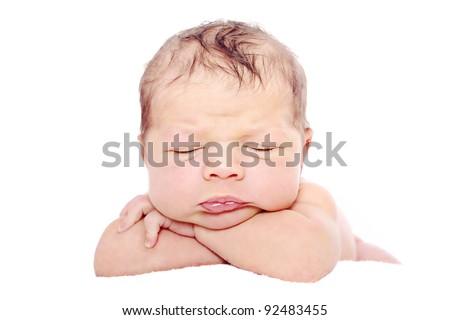 Newborn baby sleeping on white background - stock photo