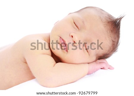 Newborn baby sleeping on white background - stock photo