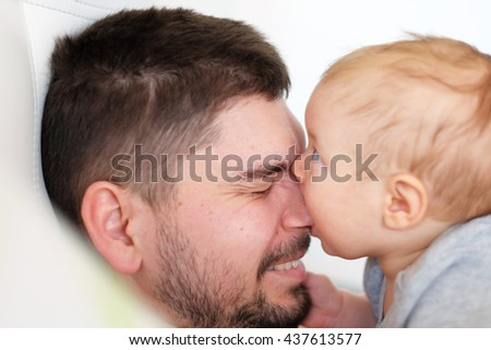 Newborn baby with his father. Shallow depth of field.  - stock photo