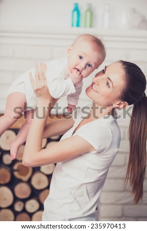 Newborn baby with his young mother - stock photo