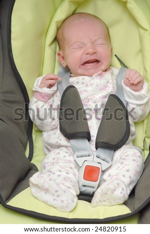 newborn crying in baby safety car chair - stock photo