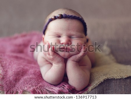 Newborn on elbows - stock photo